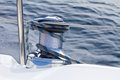 Capstan on the deck of sailing yacht with rope Royalty Free Stock Photos