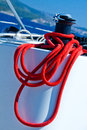 Capstan with red rope on sailing yacht Stock Photos