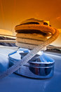 Capstan with rope on the deck of sailing yacht Stock Image