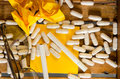 Capsule drug with yellow note and cigarette on wood pattern background Stock Images