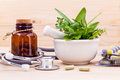 Capsule of herbal medicine alternative healthcare with stethoscope on wooden background Stock Photography