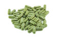 Capsule pills on white background green Stock Photos