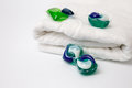 Capsules with laundry detergent on a white background. Royalty Free Stock Photo
