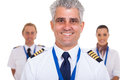 Captain airline crew cheerful senior standing in front of isolated on white Stock Photos