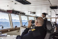 Captain of cruiser glassing out for icebergs on Arctic Ocean Royalty Free Stock Photo