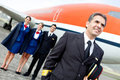 Captain pilot with cabin crew Stock Photo