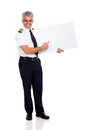 Captain pointing board happy senior airline empty isolated on white Royalty Free Stock Photography