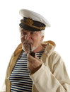 Captain sailor man in marina port with boats background Royalty Free Stock Photography