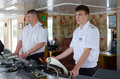 Captain of ship alexander benois and assistant in captain s cabi volga river russia july river cruise to cabin Royalty Free Stock Image