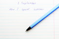 Caption ballpoint pen in a school notebook Royalty Free Stock Photo