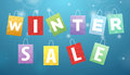 Caption winter sale on packages blue background Royalty Free Stock Photography