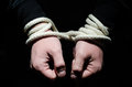 Captive hands tied up with rope Stock Images