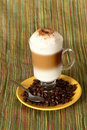 Capuccino coffee with beans Royalty Free Stock Photo