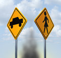 Car accident concept with two yellow warning road signs with a and child icon at a street crossing resulting in a dangerous Royalty Free Stock Photography