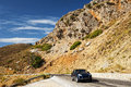 Car in an arid landscape passing through turkish area mugla province turkey Stock Image