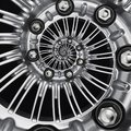 Car automobile wheel rim spiral abstract metallic fractal background. Silver hex nuts, wheel spokes spiral effect pattern backgrou Royalty Free Stock Photo