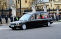 Car with baroness thatcher s coffin lady funeral leaving the house of parliament big ben and beginning its journey to st pauls Stock Photos