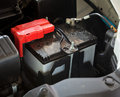 Car battery in the engine room Stock Photo