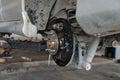Car brake repairing on scissor cranes lift Royalty Free Stock Photo