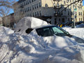 Car buried in snow blizzard  Royalty Free Stock Photo