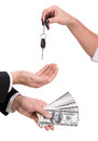 Car buying female hand holding a key and handing it over to another person man holding dollars Royalty Free Stock Image