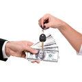 Car buying female hand holding a key and handing it over to another person man holding dollars Royalty Free Stock Photo