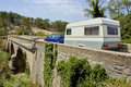 Car with caravan at bridge Royalty Free Stock Images