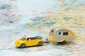Car and caravan on a map Royalty Free Stock Photo