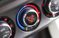 Car climate control modern focus on central button Royalty Free Stock Images