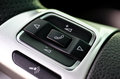 Car control keys for radio volume on leather steering wheel of m Royalty Free Stock Photo