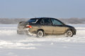 Car cornering spray snow Royalty Free Stock Photo