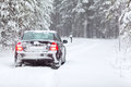 Car country road in wintry northern forest Royalty Free Stock Photography