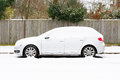 Car covered in snow parked european england Stock Image