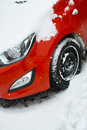 Car covered by snow red parked in winter season Stock Images