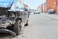 Car crash damage hit and run to vehicle in road Stock Image