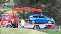 Car crash recovery hours assistance for crashed or broken cars blue by crane after accident Royalty Free Stock Photos