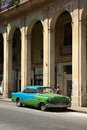 Car in cuba havana february people walk past classic american on february havana recent change law allows the cubans to trade Stock Photography
