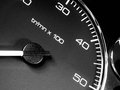 Car dashboard detail of closeup speedometer interior of tachometer background Royalty Free Stock Photo