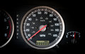 Car dashboard odometer with infinity miles on it Royalty Free Stock Photo