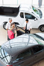 Car dealer customers overhead view of showing new to Stock Photo