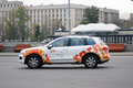 A car decorated by olympic symbols drives in the gorki recreation park in moscow it accompanies the relay of the flame on Stock Photo