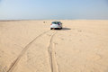 Car in the desert of qatar middle east Royalty Free Stock Photo