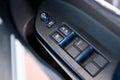 Car door interior arm rest with window control panel, door lock Royalty Free Stock Photo
