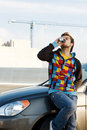 Car driver with a refreshing drink Royalty Free Stock Photos