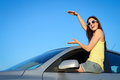 Car driving copy space for banner female driver sitting on new window holding virtual young woman on summer roadtrip license or Stock Photo