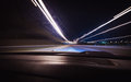 A car driving on a motorway at high speeds inside view color toned image selective focus lights Stock Photography