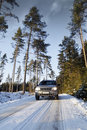 Car driving in snowy landscape Royalty Free Stock Photography
