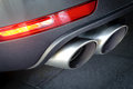 Car dual exhaust pipe close up of a Stock Images