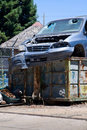 Car in dumpster Stock Photo