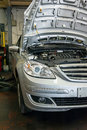 Car engine inspection open hood in a garage Stock Images